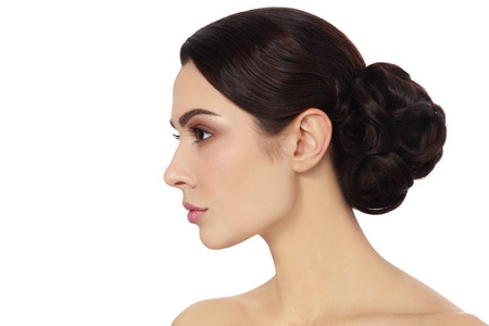 Foto für Profile portrait of young beautiful woman with stylish hair bun over white background, copy space - Lizenzfreies Bild