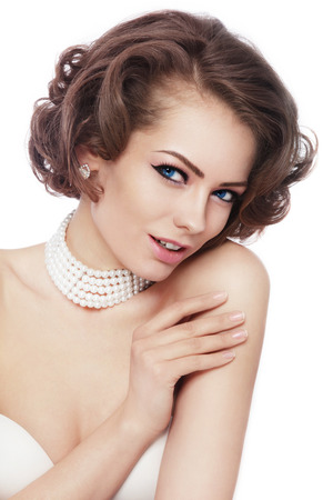 Photo pour Young beautiful sexy woman with stylish curly hairdo and pearl nacklace over white background, copy space - image libre de droit
