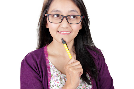 Close up face of smiling Asian woman looking up thinking with interested expression, isolated on white background