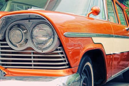 Photo pour Closeup of oldtimer car with orange colored paint on automobile show - image libre de droit