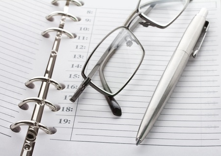 close-up notebook, pen and glasses