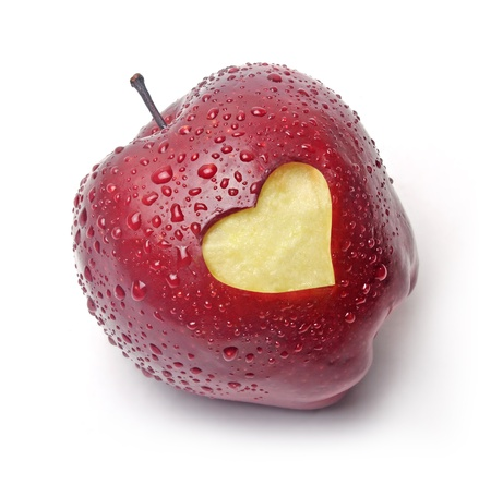 Fresh red apple with a heart symbol against white background