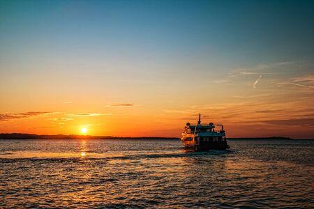 Photo for Sunset with ship sailing to the Brijuni Islands in Fazana, Croatia. - Royalty Free Image