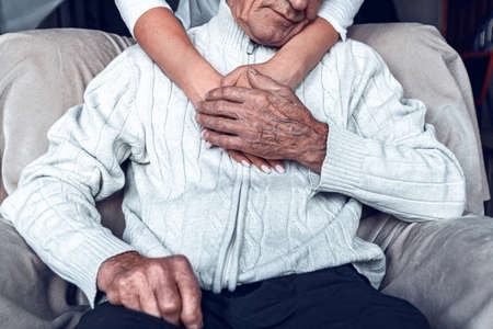Foto de Taking care of the elderly during a pandemic COVID-19. Self-isolation of the elderly. Support for older people during quarantine - Imagen libre de derechos