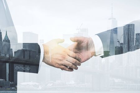 Photo pour Multi exposure of handshake two businessmen on city skyline background, cooperation and coworking concept - image libre de droit