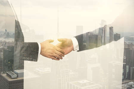 Photo pour Multi exposure of handshake of two businessmen on city skyscrapers background, collaboration and teamwork concept - image libre de droit