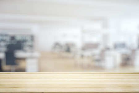 Photo pour Empty table top made of wooden dies with sunny furnished office on background, template - image libre de droit