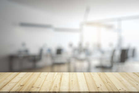 Photo pour Blank wooden table top with light furnished office on background, mockup - image libre de droit