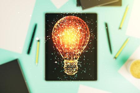 Photo pour Creative light bulb hologram and modern digital tablet on background, idea concept. Multiexposure - image libre de droit