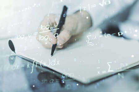 Photo pour Creative scientific formula concept with man hand writing in notebook on background. Multiexposure - image libre de droit
