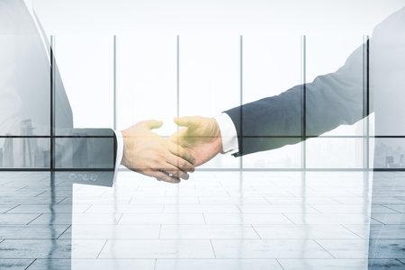 Photo pour Double exposure of handshake two businessmen on empty office interior background, real estate concept - image libre de droit