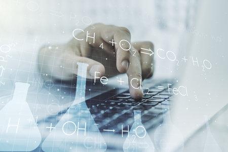 Photo pour Creative chemistry concept with hands typing on laptop on background. Multi exposure - image libre de droit