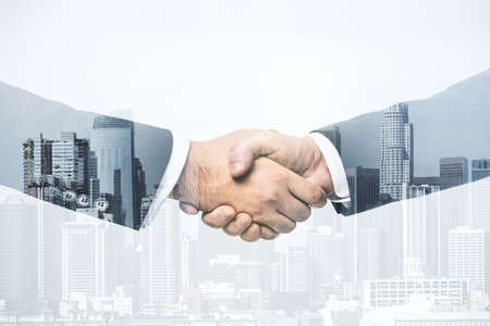 Photo pour Handshake of two businessmen on modern cityscape background, deal and trading concept. Multiexposure - image libre de droit
