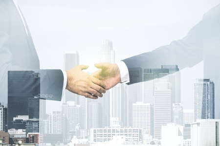 Photo pour Double exposure of handshake two businessmen on modern skyscrapers background, research and strategy concept - image libre de droit