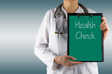 Photo for Health Check  - Female doctor's hand holding medical clipboard and stethoscope. Concept of Healthcare And Medicine. Copy space. - Royalty Free Image