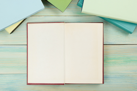 Photo for Open book with blank pages on textured wood background. Copy space. - Royalty Free Image