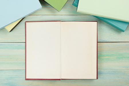 Foto de Open book with blank pages on textured wood background. Copy space. - Imagen libre de derechos