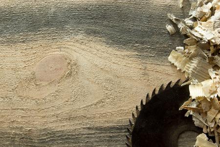 Photo pour Carpenter tools on wooden table with sawdust. Carpenter workplace top view. - image libre de droit