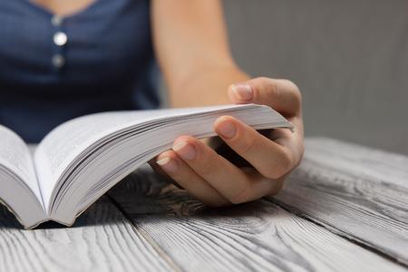 Foto de Closeup hand open book for reading concept background. - Imagen libre de derechos