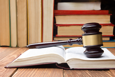 Photo pour Law concept - Law book with a wooden judges gavel on table in a courtroom or law enforcement office - image libre de droit