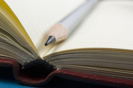 Foto de Notepad and pencil macro shot. Copy space for text. - Imagen libre de derechos