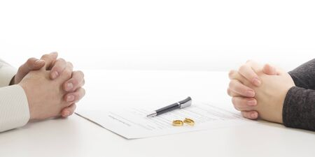 Photo pour Divorce concept. Hands of wife, husband signing decree of divorce, canceling marriage, legal separation documents. - image libre de droit