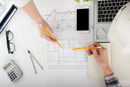 Photo pour Architects working on blueprint, real estate project. Architect workplace. Construction concept. Engineering tools. - image libre de droit