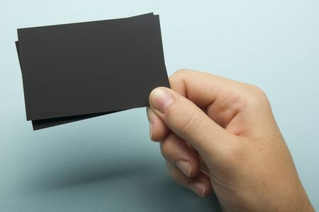 Photo pour Hand holding white business card on abstract background - image libre de droit