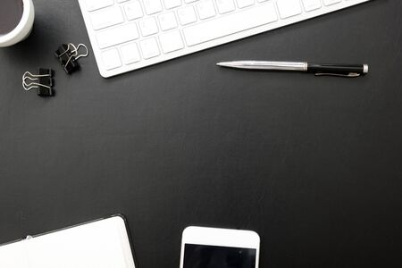 Foto de Black desk office with laptop, smartphone and other work supplies with cup of coffee. Top view with copy space for input the text. Designer workspace on desk table essential elements on flat lay - Imagen libre de derechos