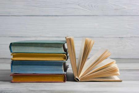 Photo pour Open book, hardback books on wooden table. Back to school. Copy space - image libre de droit
