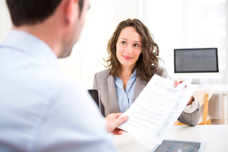 Photo for View of a Young attractive woman during job interview - Royalty Free Image