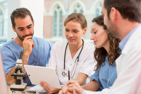 Photo for View of a Medical team working at the hospital all together - Royalty Free Image