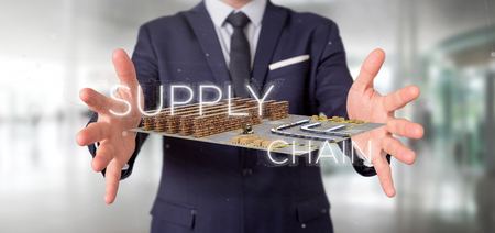 Photo pour View of a Businessman holding a Supply Chain title with a warehouse on background 3d rendering - image libre de droit