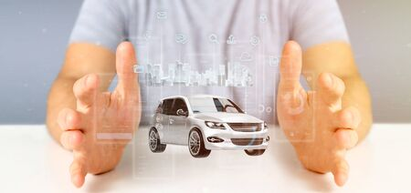 Photo pour View of Businessman holding Dashboard smartcar interface with multimedia icon and city map on a background 3d rendering - image libre de droit