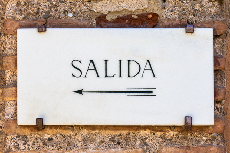Simple marble cartel with the word Salida (Exit in Spanish)