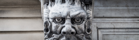 Photo pour This city is famous to be a corner of two global magician triangles. This is a protective mask of stone on the top of a luxury palace entrance, dated around 1800, Italy, Turin. - image libre de droit