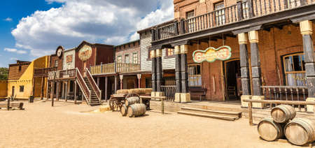 Photo for ALMERIA, SPAIN - CIRCA AUGUST 2020: Vintage Far West town with saloon. Old wooden architecture in Wild West with blue sky background. - Royalty Free Image