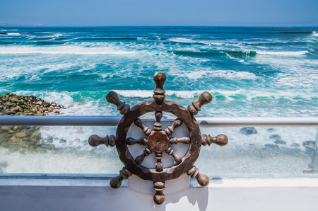 Beautiful view of the sea from a house on the beach with a helm of a pirate ship