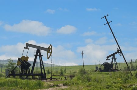 oil pumps are in the valley of mountains
