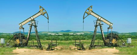 two oil pump is on a background sky