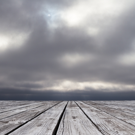 wood floor and somber sky