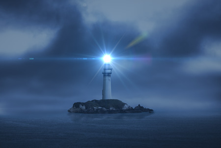 Photo pour lighthouse searchlight beam through marine air at night - image libre de droit
