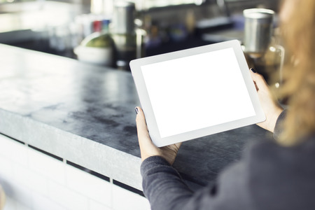 Photo pour girl with blank digital tablet in cafe, mock up - image libre de droit