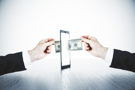 Photo pour Money transfer with man hands and digital tablet concept - image libre de droit