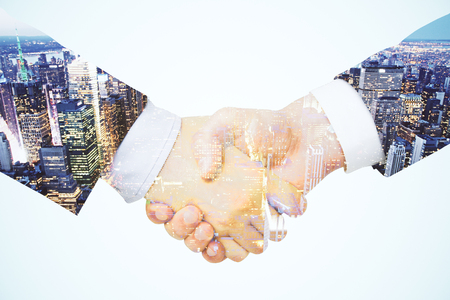 Photo for Double exposure with a handshake between two businessmen - Royalty Free Image