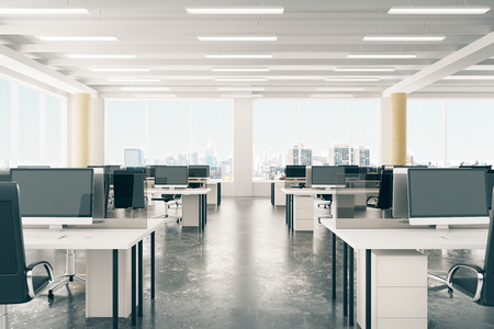Open space office in loft style hangar with windows in floor and city view