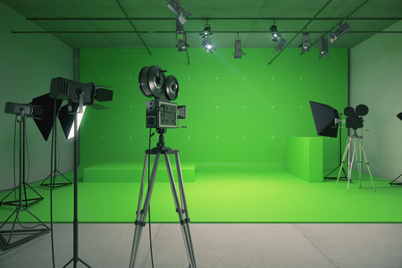 Photo for Modern empty green photo studio with  old style movie camera - Royalty Free Image