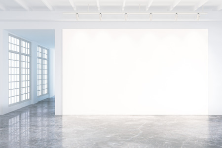 Photo pour Mock up of blank poster in modern loft interior with big windows and concrete floor - image libre de droit