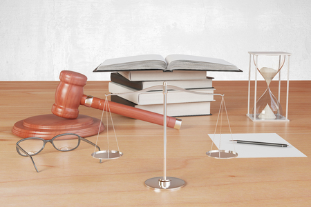 Truth scales with gavel, hourglass and books on wooden table