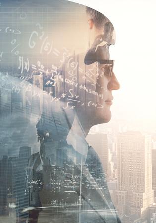Photo pour Side portrait of businessman on abstract city background with mathematical formulas. Education and creative concept. Double exposure  - image libre de droit